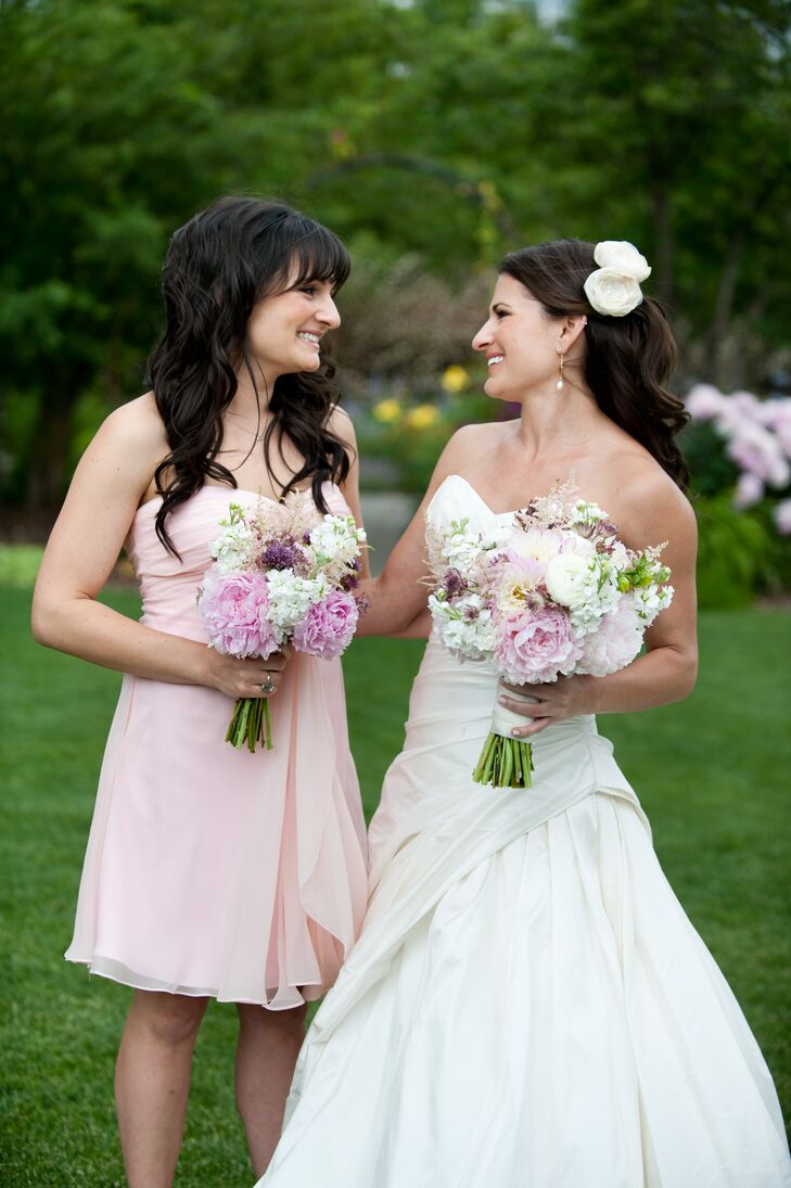 The bridesmaids picked out their own cocktail-length blush pink dresses.