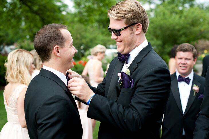 The groom and groomsmen wore black tuxes, purple and white polka-dot bow ties and gray and pink-striped socks.