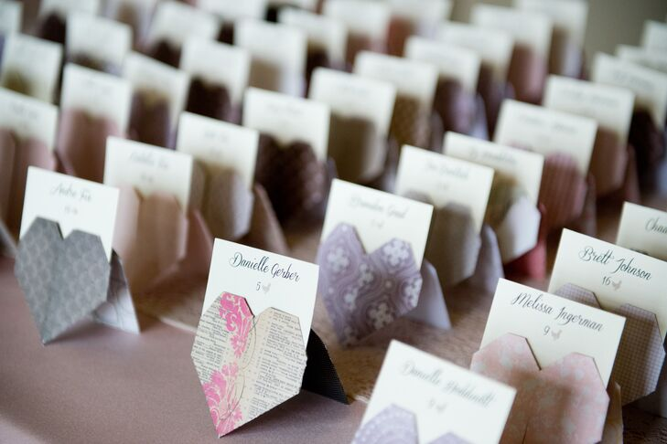 Caitlin added a little personal touch to her wedding with DIY origami heart escort cards in the wedding colors.