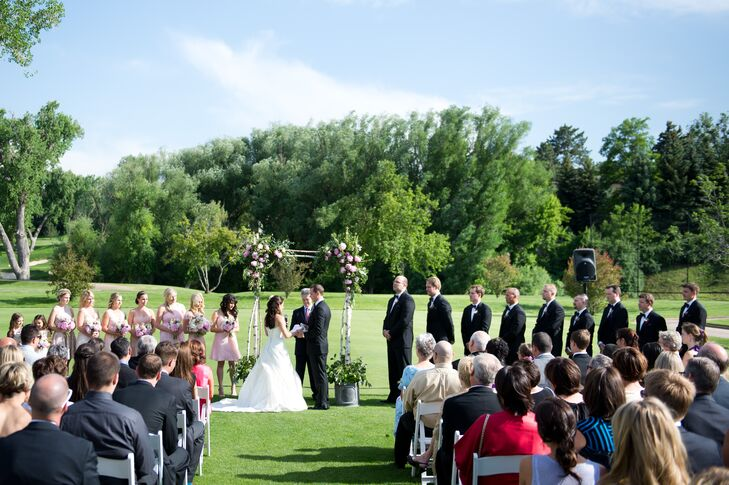 """Caitlin and Benjy exchanged vows at the Denver Country Club. """"It had beautiful flowers all over their land, so there was greenery and nature at every turn,"""" Caitlin says. The couple decorated with a birch wood and pink peony arbor for a rustic, garden feel."""