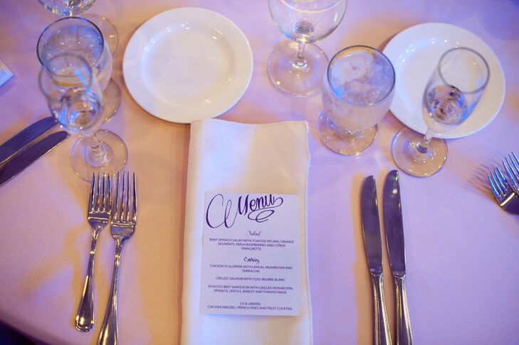 The bride made all of the stationery herself including the elegant white and plum menu cards.