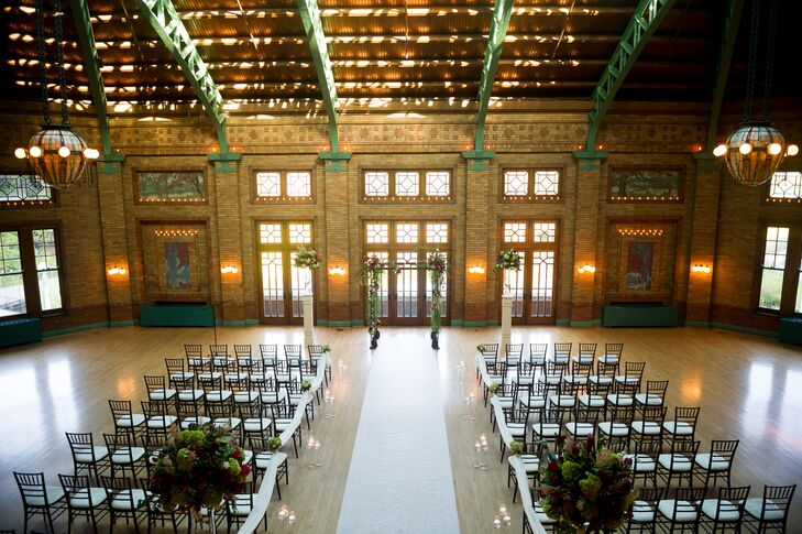 With its vaulted ceiling, stained-glass windows and elegant chandeliers, Cafe Brauer's Great Hall was the ideal setting for the indoor ceremony.