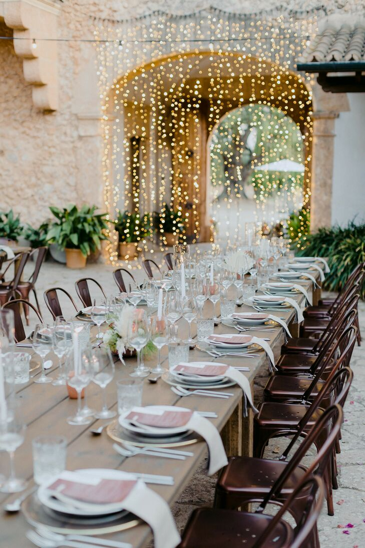 Long Reception Table and Wall of String Lights for Mallorca Wedding Reception