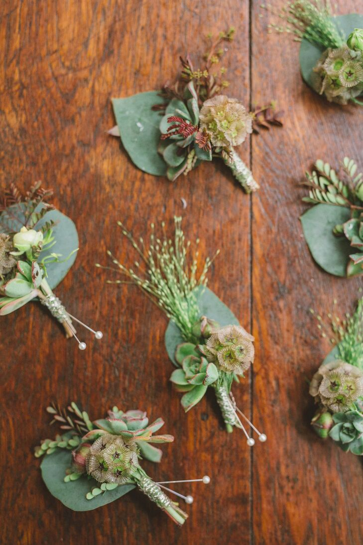 Each boutonniere centered on a petite succulent sprig backed with a eucalyptus leaf.