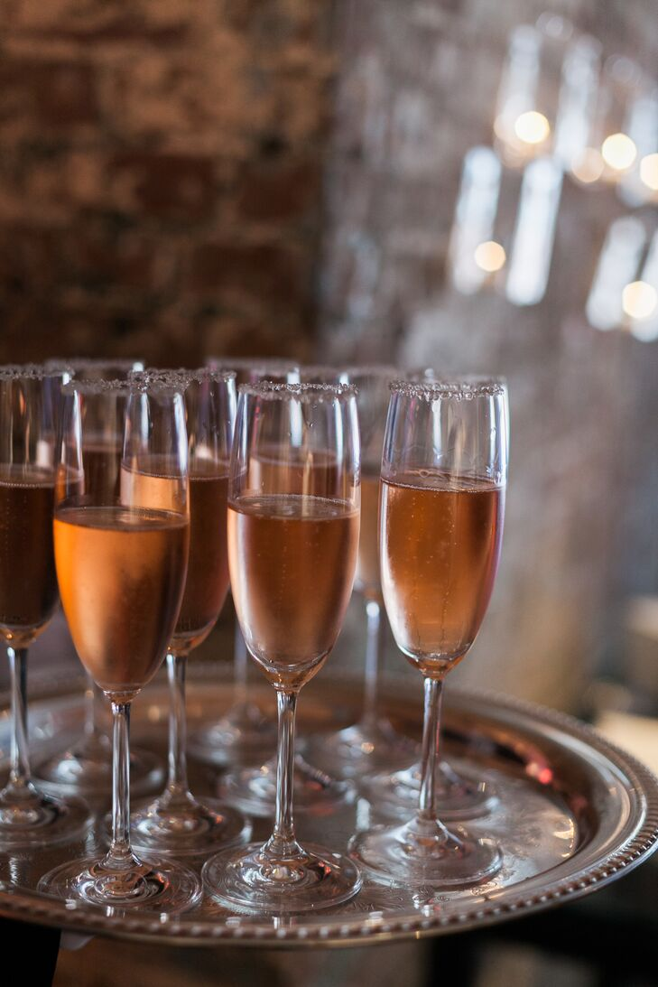 The newlyweds served sparkling rose as their signature cocktail—a drink meant to mimic the color of Cecilia's dress. Each cocktail was rimmed with silver shimmer to add just the right amount of sparkle.