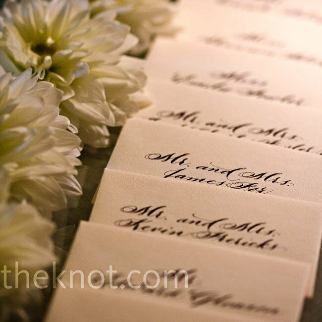 As a way to tie in fancy elements, rows of fresh white dahlias were placed alongside the escort cards.
