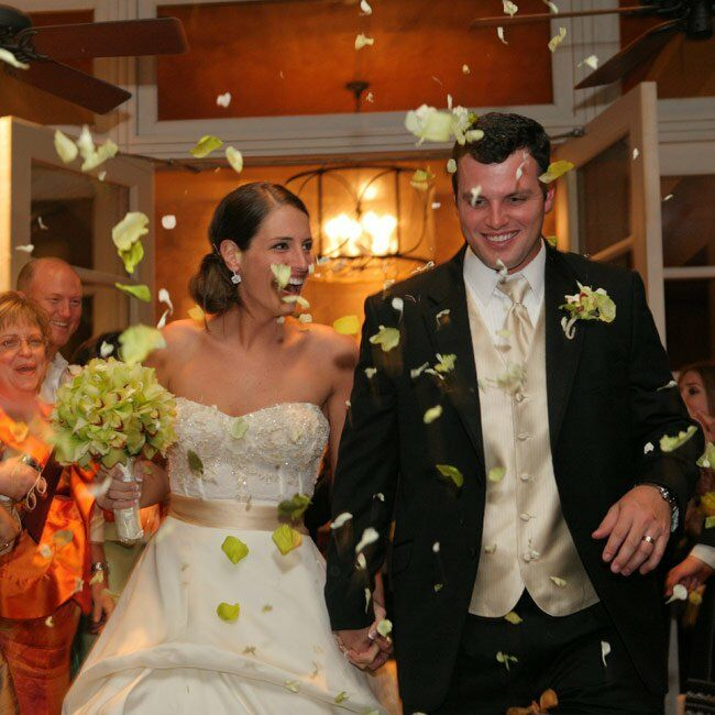 Andrea and Matt's guests tossed green flower petals into the air as the newlyweds made their escape.