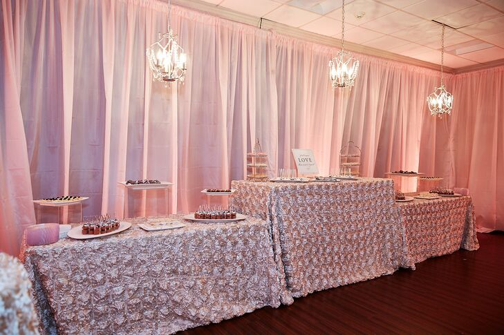 In addition to their nine-tier wedding cake, Maria and Chris enjoyed a dessert bar including a variety of macarons, cake pops, Rice Krispies treats, lemon tarts, salted-caramel brownies, chocolate mousse parfaits and chocolate-covered strawberries. The tables were draped with textured blush linens for added drama.