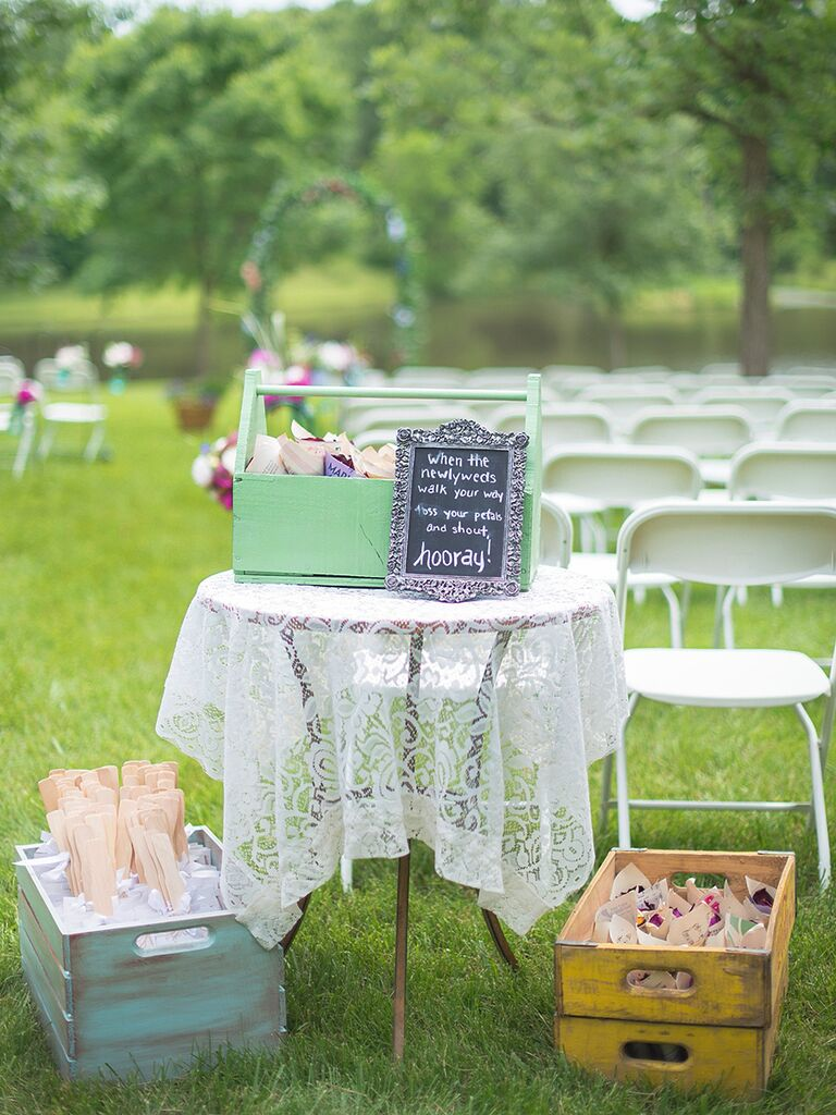 Vintage table and wooden crates for wedding programs and petals to toss