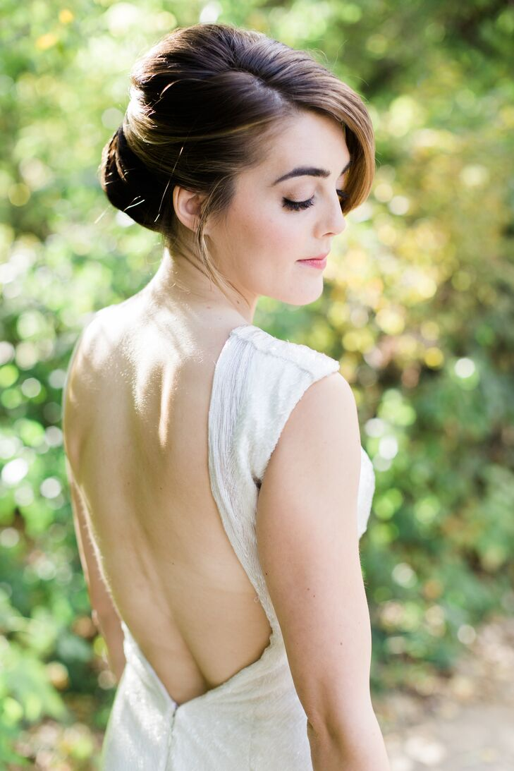 Kelly wore her hair in a modern chignon.