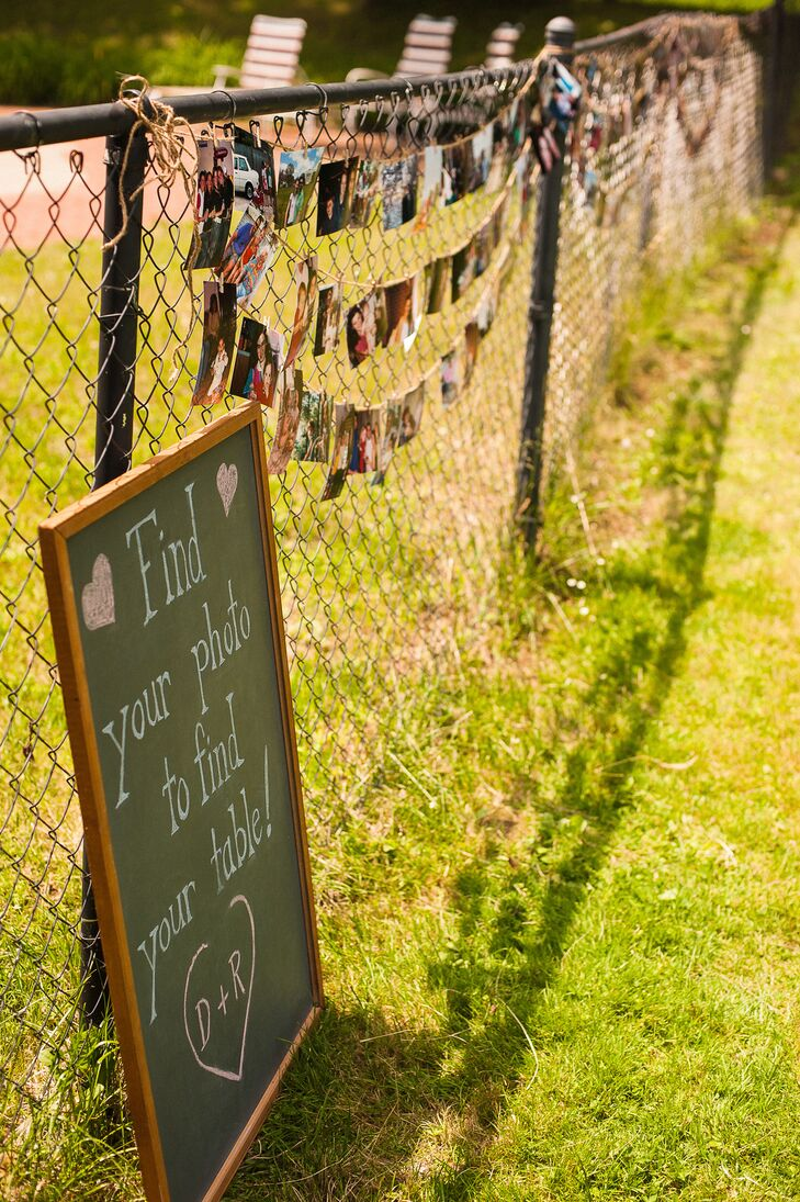 """""""Instead of having traditional escort cards, the guest were directed to hanging pictures on a fence at the farm where they were instructed to 'Find your photo to find your table,"""" says the couple. """"There was a mix of old and newer pictures of each guest with either the bride, groom, or both."""""""