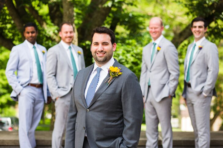 "Dan and his groomsmen wore custom suits from Knot Standard with ties from Vineyard Vines. ""The groom's tie depicted hearts, while the groomsmen wore ties with margaritas as I am known among our friends for making the best margaritas!"" says the bride."