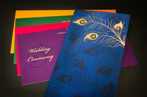 Colorful Peacock Feather-Adorned Invitations