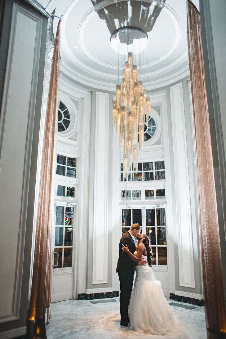 """""""The elegance of the ballroom and lobby enhanced the overall look of the wedding as the decor fit our color scheme,"""" Rachel says of the opulent interior of Georgian Terrace in Atlanta, Georgia."""