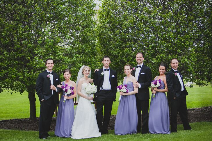 Bridal Party In Purple Bridesmaid Dresses And Black Groomsmen Tuxedos