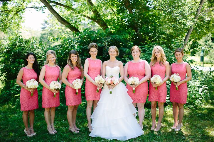 Kelsey's bridesmaids wore coral shift dresses. The women accessorized with their own jewelry and wore either simple nude peep-toe pumps or round-toe heels.