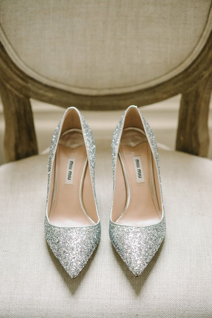 """Juliette completed her sparkly Rachel Gilbert wedding dress with equally glamorous litter-covered Mui Mui pumps. Although she picked out these shoes for her gorgeous Magnolia Plantation nuptials, it ended up raining all day, so the grass was soggy. """"My superhero photographer, Jillian, had packed her own gum boots for me to wear with her husband's Christmas socks, just in case I needed them,"""" Juliette says. """"Now every time I see Hunter gum boots, it reminds me of our wedding."""""""