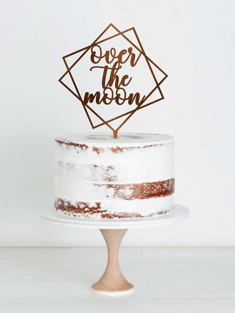 Over the Moon geometric wedding cake topper