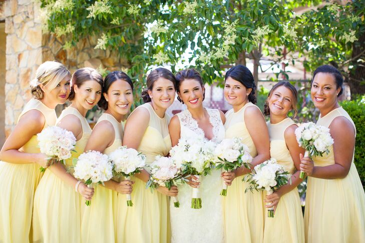 In keeping with the wedding's cheerful, Amalfi Coast–inspired color palette, Katherine dressed her bridesmaids in soft lemon yellow. The knee-length J.Crew dresses had a classic, sophisticated feel with an A-line silhouette and an illusion sweetheart neckline.