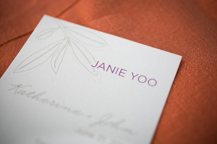 For the reception, Katherine and John decided to get creative and combined the place cards and menus into a single entity. After consulting the custom wooden seating chart, guests headed to their tables and found a menu card with their name on it. The menus featured olive leaf illustrations that tied in with the vineyard theme.