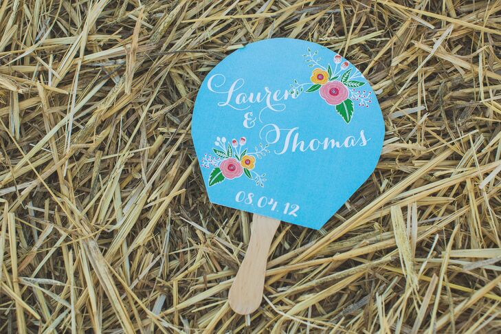 Lauren and Thomas's bright blue programs doubled as fans and were decorated with an artisanal typeface and floral print.