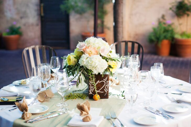 The florists at Visual Design Impact outdid themselves when it came to the centerpieces, putting together arrangements of soft pastel blooms like roses and hydrangeas accented with grapes and apricots.