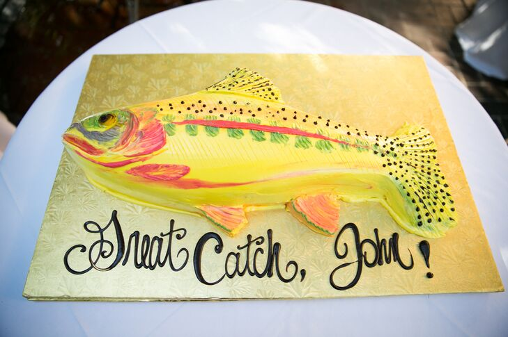 "Katherine wouldn't let the day go by without at least one surprise. When she and John arrived at the reception, he was blown away by the groom's cake, made by Sweet on Cakes. ""It was shaped and decorated as a golden trout,  the one fish I have never been able to catch!"" says John."