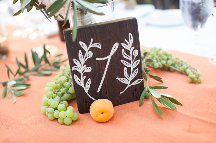 Katherine and John hired a local artist to make all the wedding's signage, from the table numbers to the seating chart.