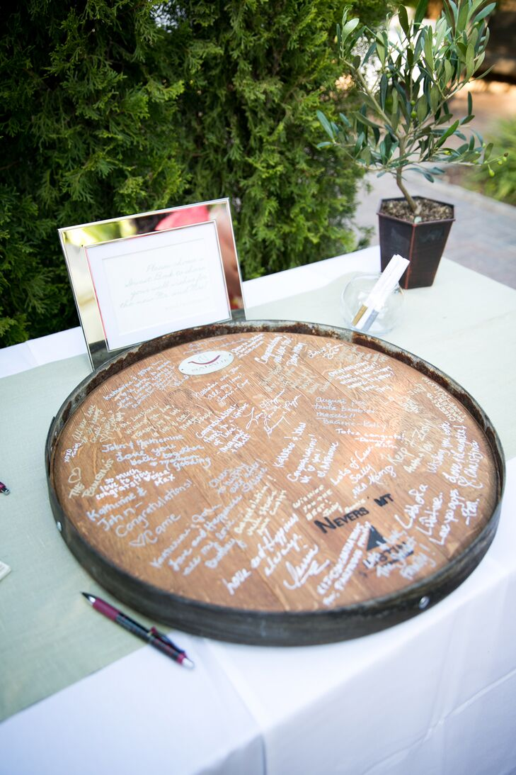 The pair had a reclaimed wine barrel converted into a lazy Susan upon which friends and family wrote their well wishes and advice.