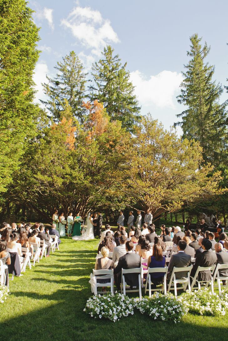 To highlight the beauty of the Wheatleigh's setting, Fanny and Brian held their ceremony outdoors in the venue's sculpture garden. We kept the décor to a minimum because we felt the garden itself was already so lush and beautiful, says Fanny.
