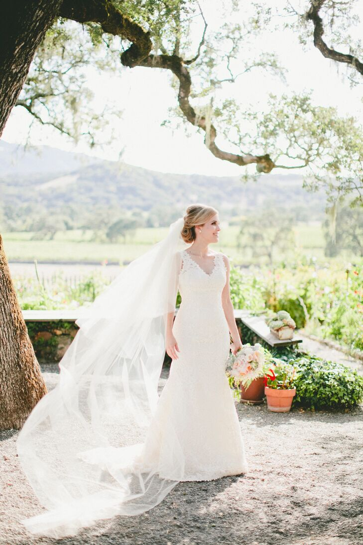 When it came to her wedding dress, Molly wanted a classic, romantic style that would complement the scenic setting and rustic feel of the Beltane Ranch. She settled on a lace Rosa Clara gown with a mermaid silhouette and v-shaped neckline that offered just the right balance of timeless elegance and subtle sex appeal. She accessorized the look with a dramatic cathedral blusher veil and pearl earrings that her father had given her mother.