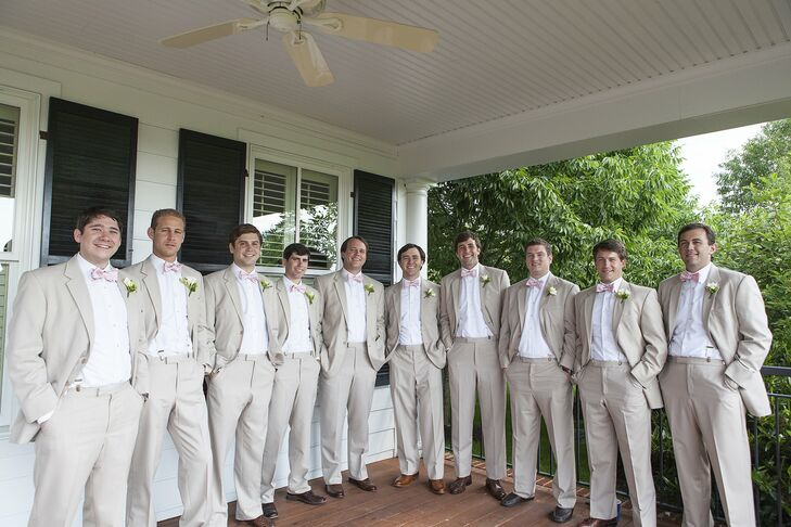 The six groomsmen and three ushers rented khaki suits, and Carter and Patrick purchased matching bow ties from Collared Greens as their groomsmen gifts.