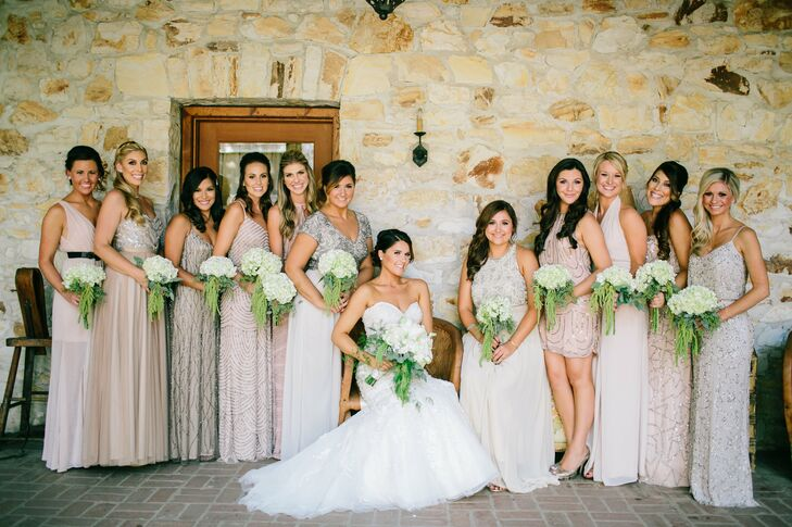 The bride wanted her bridesmaids to be able to express their individuality so she let them pick their dresses. She went with her sisters and Maid of Honor to choose a starting point and gave everyone a palette of light gold, blush and silver giving them free rein on length and embellishment design.
