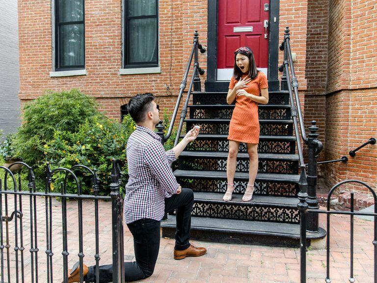 Man proposing to girlfriend on front doorstep