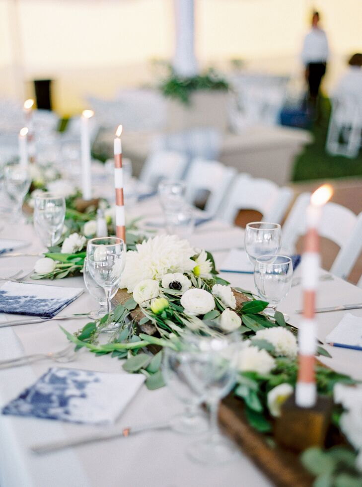The centerpieces were the reception's piece de resistance, with fresh herbs, sweet peas, dahlias, ranunculus, tulips, anemones, ferns, eucalyptus and more bringing life to the foraged wooden planks and crisp white linens.