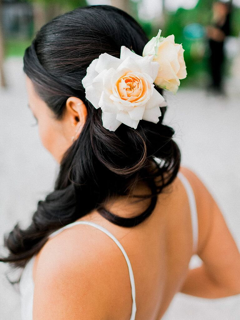 Long curly wedding hairstyle with flowers