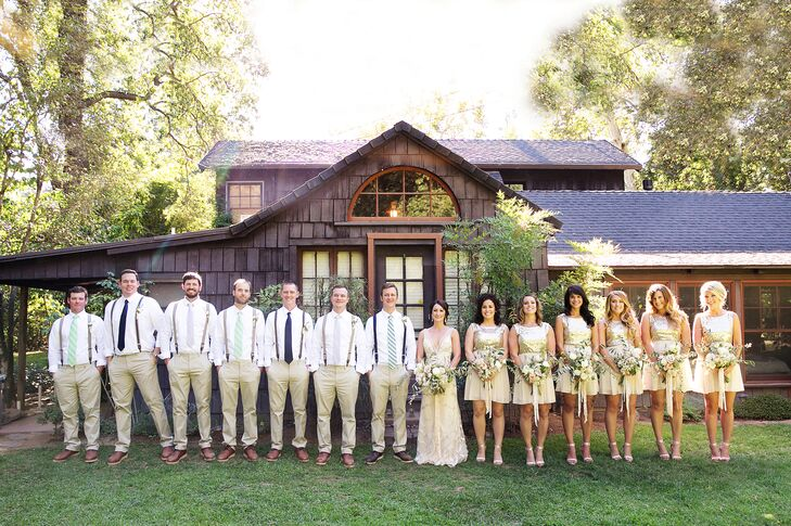 "Bonny and Doug stood in the middle of their wedding party on the lawn at Gale Vineyards in Durham, California, with bridesmaids dressed in gold dresses while groomsmen wore khaki pants and white shirts. ""I knew I wanted the bridesmaid dresses to have some element of sequins, and I wanted complete uniformity with their attire,"" Bonny says. ""Doug didn't want the full suit and tie, so we settled on the white shirts and slim-fitting pants. I had to fight for the patterned socks and suspenders, but even the guys had to admit they looked pretty dang good."""