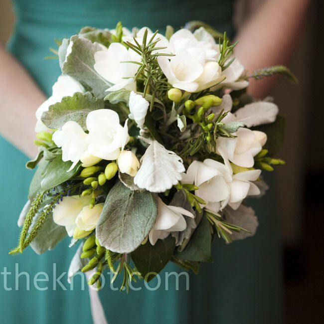The bridesmaids carried loose organic-looking bunches of white flowers, lily of the valley and herbs.