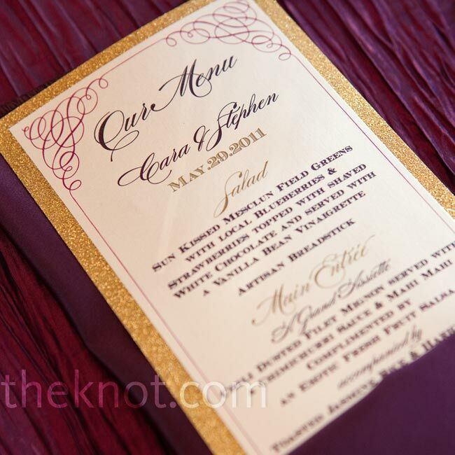 The gold-backed menu cards matched the escort card design and were tucked into plum-colored linen napkins.