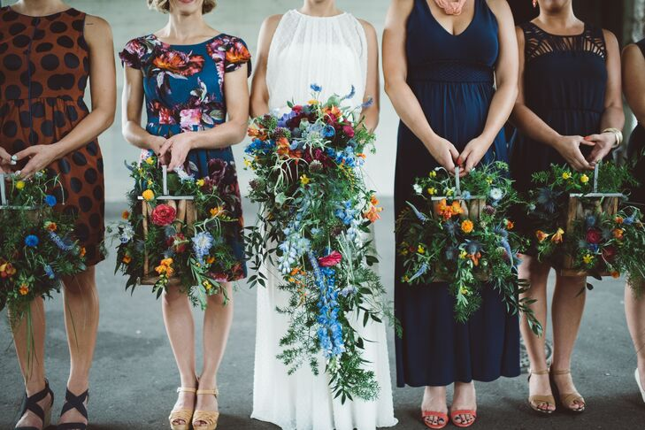 "Out-of-the-box arrangements included a fresh mix of freesia, poppy pods and thistle, while bridesmaids carried flower-filled lanterns in lieu of candles or bouquets. ""Once the ceremony was over, we repurposed the lanterns as table centerpieces,"" Shorey says."