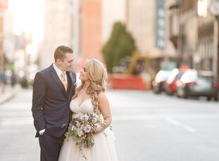 Drawing inspiration from a colorful Ted Baker clutch the bride spotted while shopping, Esther Wolf (25 and an account manager) and Stephen Sharr (27 a