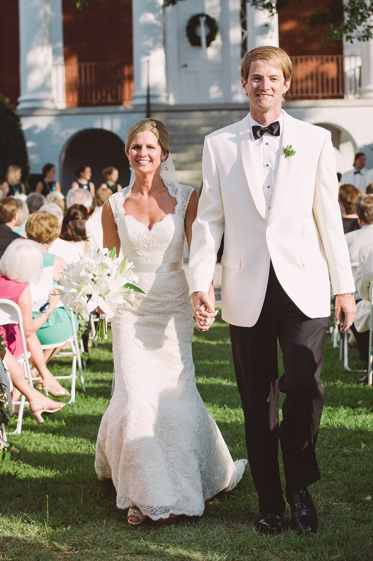 Claire wore a sheath lace Modern Trousseau wedding dress with a keyhole back and sweetheart neckline. She loved the lace rosettes on the skirt and how the chic dress complemented the ultra-chic wedding vibe.