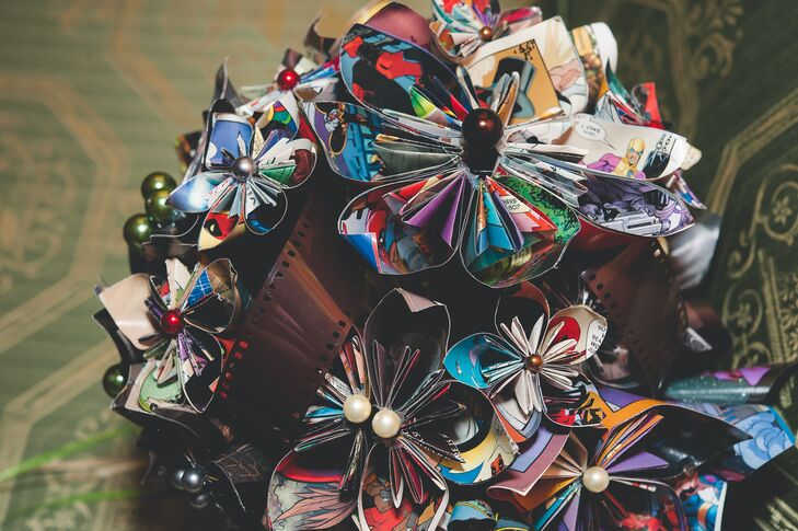 Not only did the bride craft the centrepieces, but she even crafted her bouquet out of comic book pages. She first made the pages into origami flowers and then arranged them into the final bouquet.