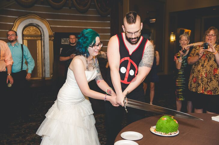 Felicia and Joe made sure to keep everything in their fun, quirky style which included the cake. Their Hobbit Shire themed cake was cut with a sword inspired by Zelda.