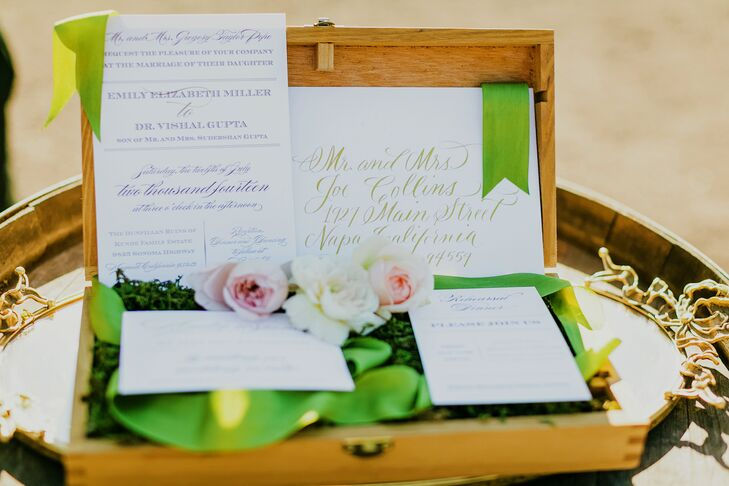 "Vishal and Emily's take on a guest book adhered perfectly the day's ""come away with me"" theme. ""Vishal and I like to travel, and we collect postcards from the places we've been,"" Emily says. ""We included a sign-in table where guests wrote messages on the backs of our postcard collection and placed them inside a small vintage suitcase. We had the same theme at our rehearsal dinner, where guests pinned destinations on a large map where they would like to see us travel to next."""