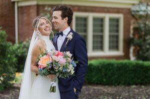Modern Couple with Formal High-Neck Dress, Navy Suit and Colorful Bouquet