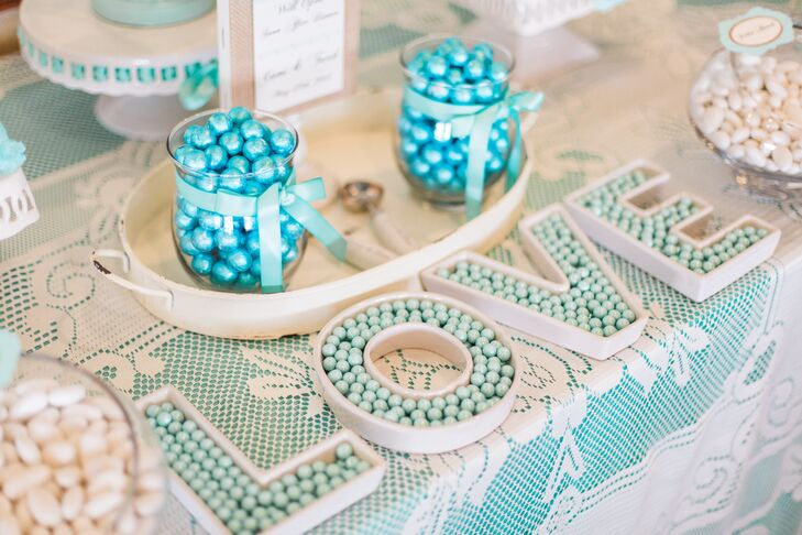 Cami loves blue-green colors, such as aqua and turquoise, so it was no surprise that their candy bar was filled with sweets in those same hues. After dinner, they opened a blue and white candy bar from Florida Candy Buffets with rock candy, gum balls, jelly beans and more.