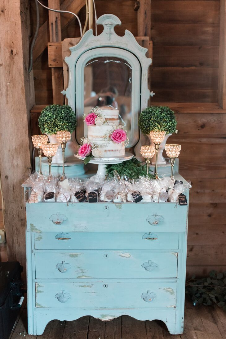 Rustic Cake and Favor Display on Light Blue Vanity