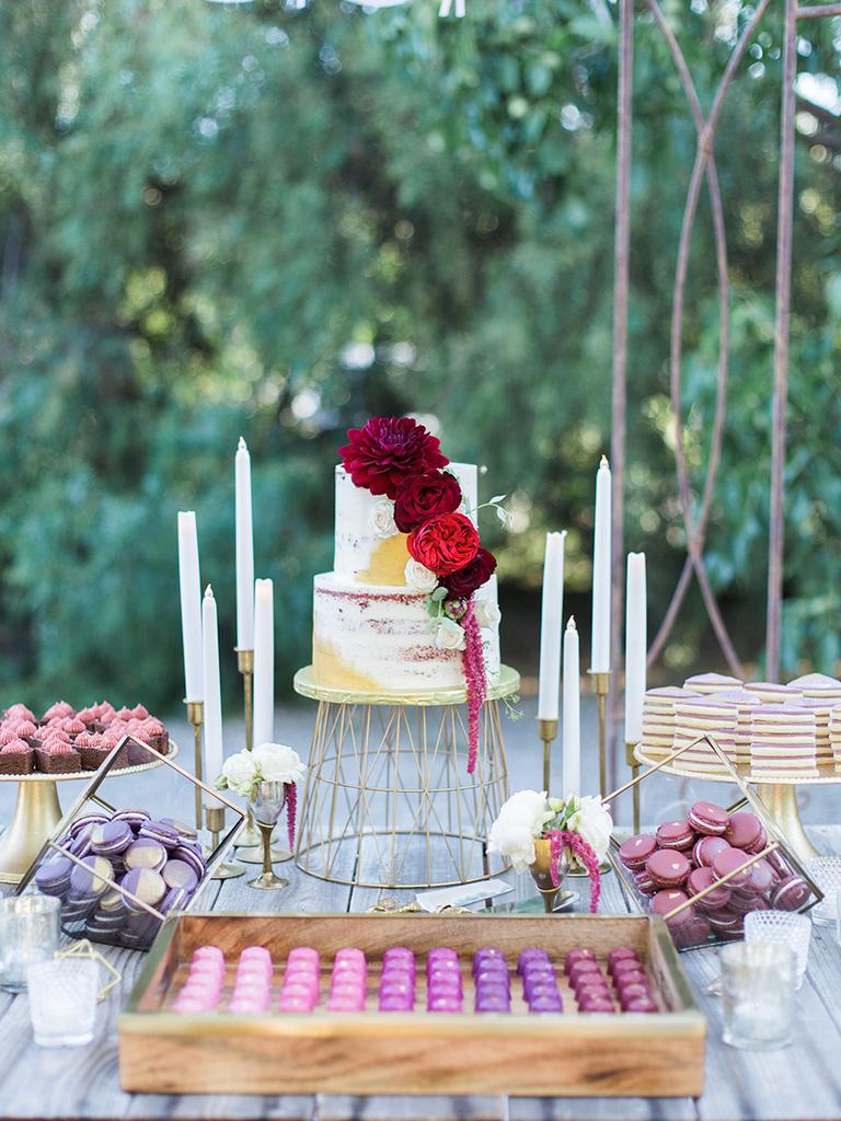 purple and pink wedding dessert table