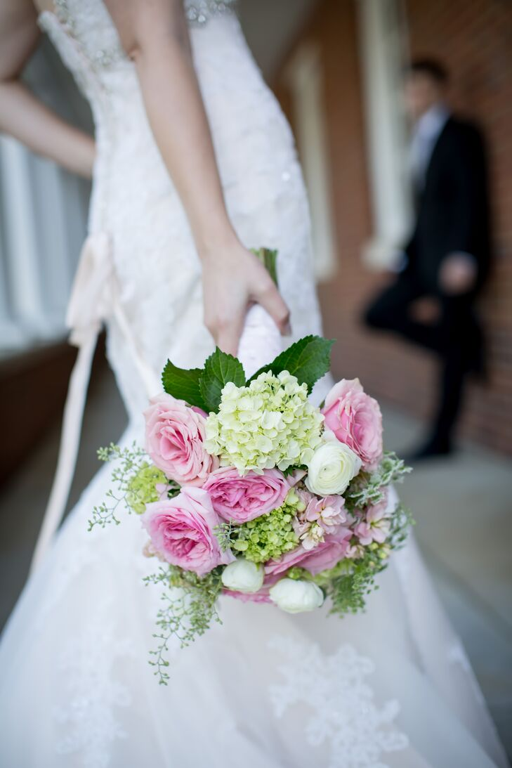 Kelly's bouquet felt like spring. The blend of pink roses, white ranunculus, hydrangeas, Queen Anne's lace and greenery was both pretty and classic for her Southern wedding.